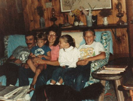 Family photo of 5 on couch
