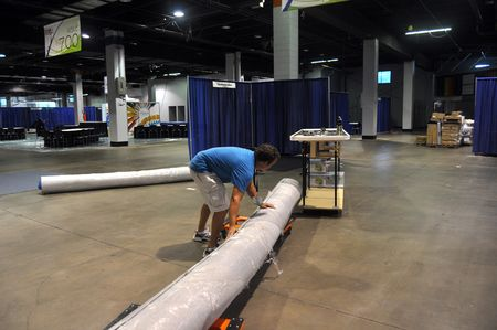 Set up david rolling out carpet