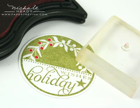Stamping berries on wreath